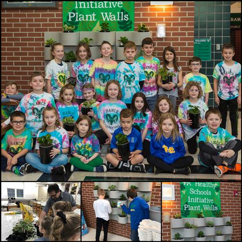 Students by Plant Wall